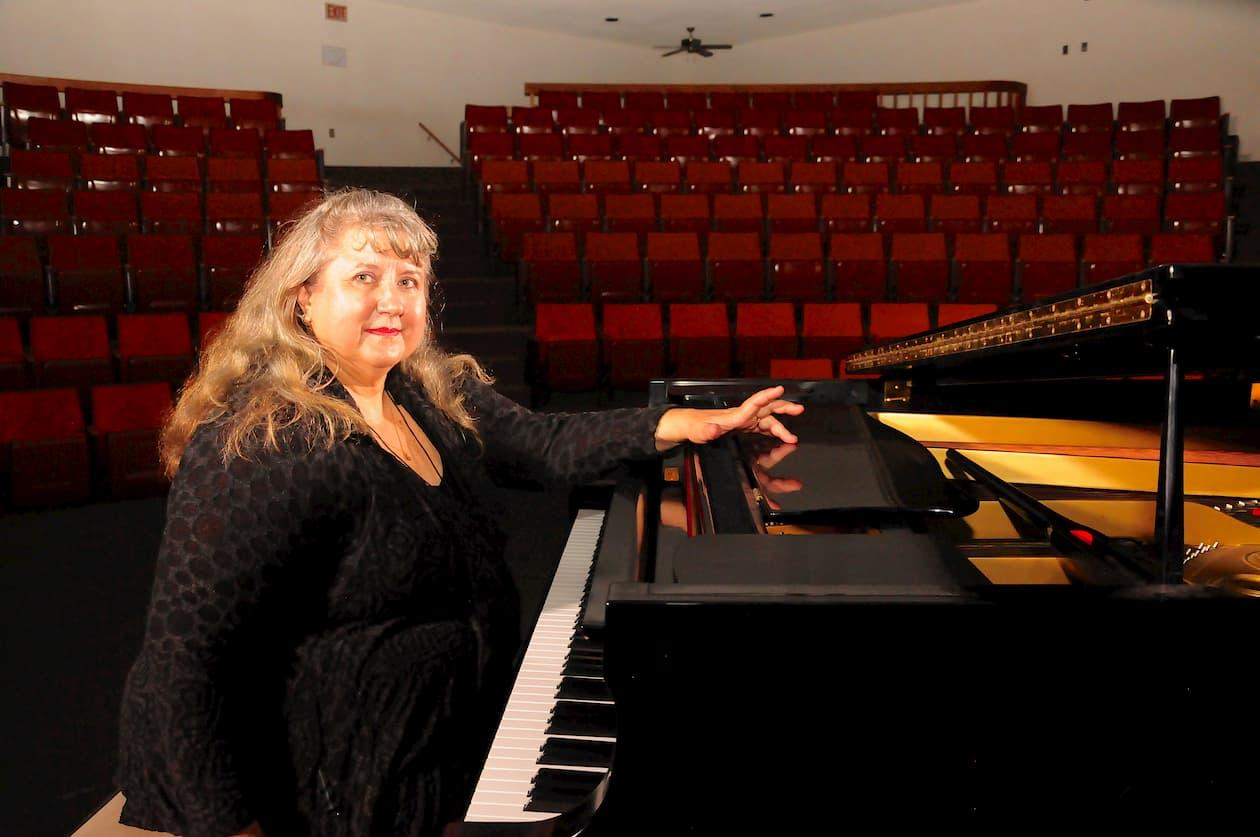 Ida Edwards plays piano in Athabasca