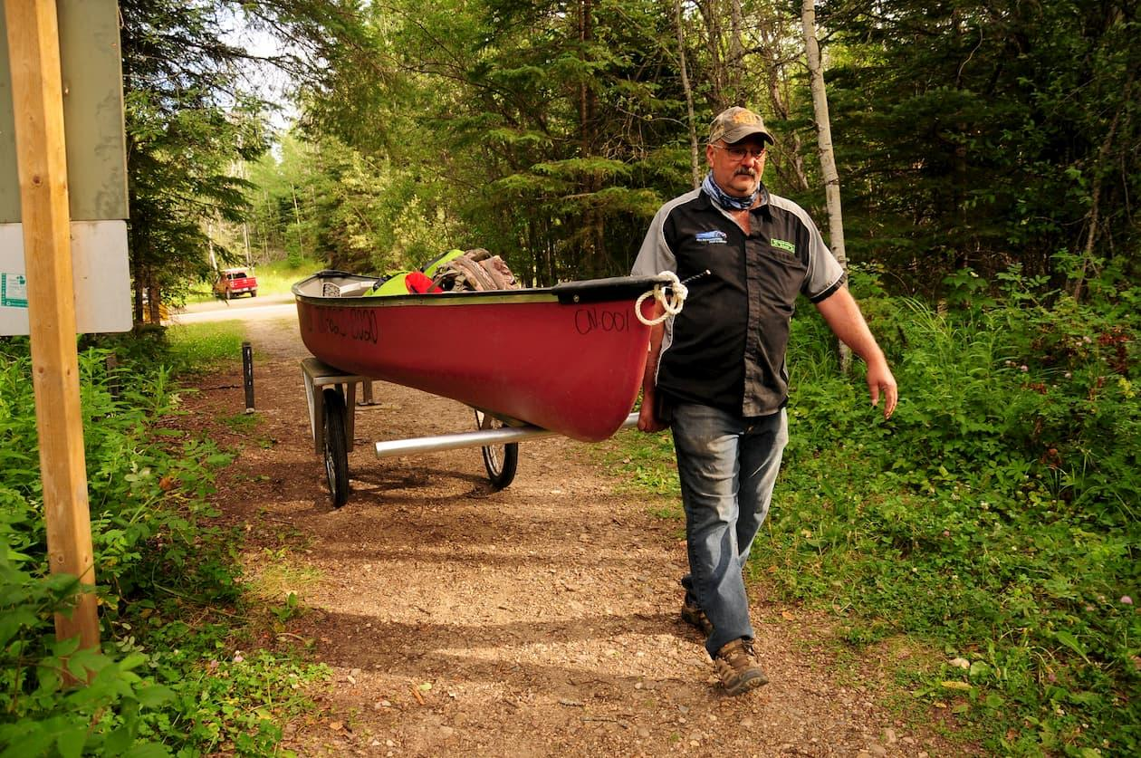 Carrying a canoe to the lake in Lac La Biche