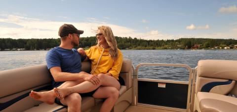A couple cozy up on a boat on the lake in Athabasca